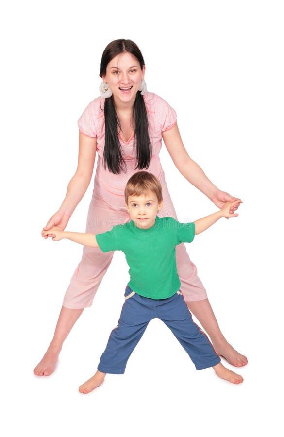 ребенок делая девушку тренировки супоросую стоковые фотографии rf