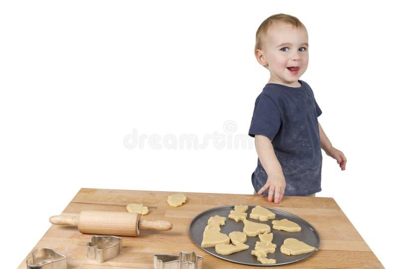 Ребенок делая печенья стоковое фото