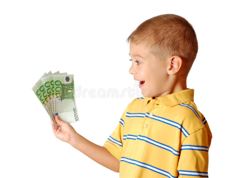 ребенок держит деньги стоковое изображение