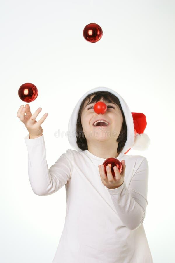 ребенок играет с украшением рождества стоковая фотография rf