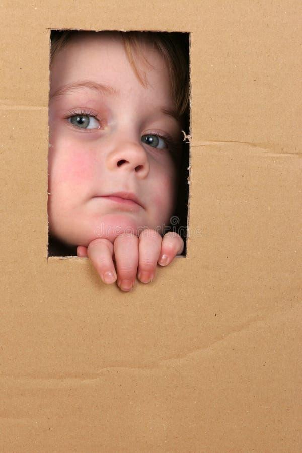 ребенок коробки стоковая фотография