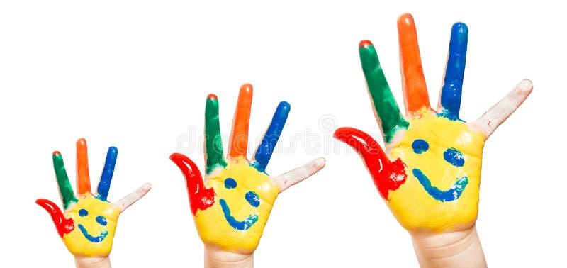 Ребенок покрашенный рукой. Белая предпосылка стоковые фотографии rf