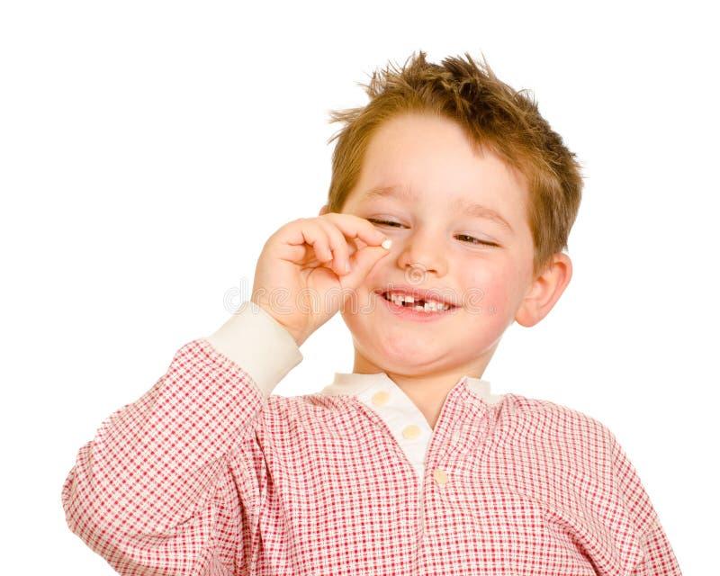 Ребенок с потерянным зубом стоковая фотография rf