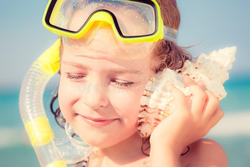 ребенок пляжа счастливый стоковое изображение rf