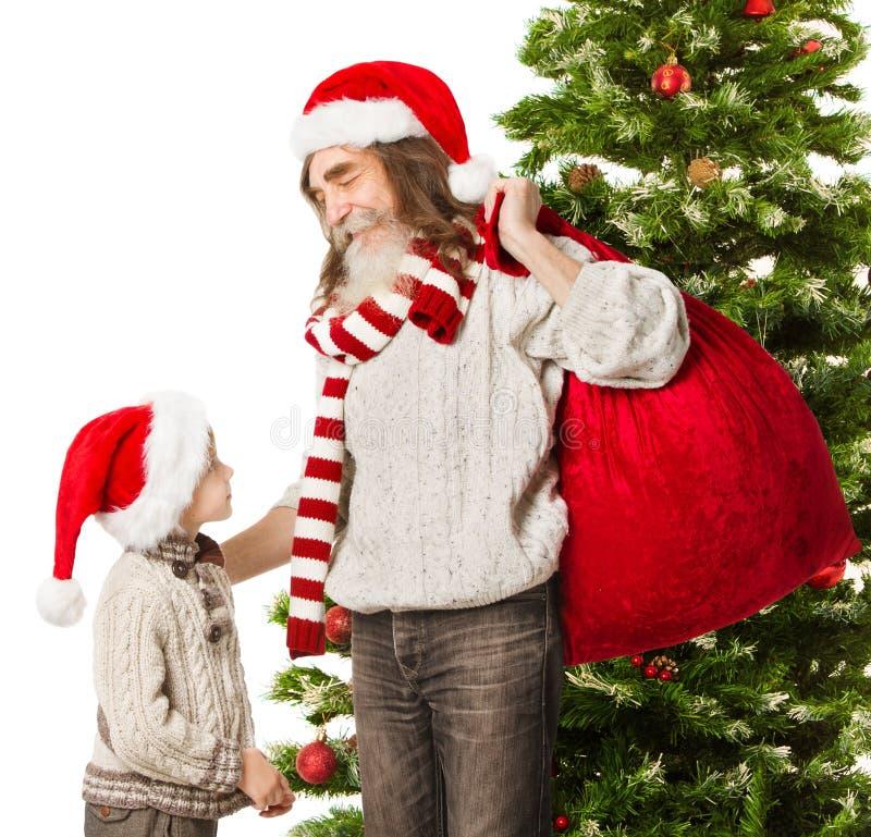 Ребенок рождества, дед Санта Клауса с красным цветом  стоковое фото