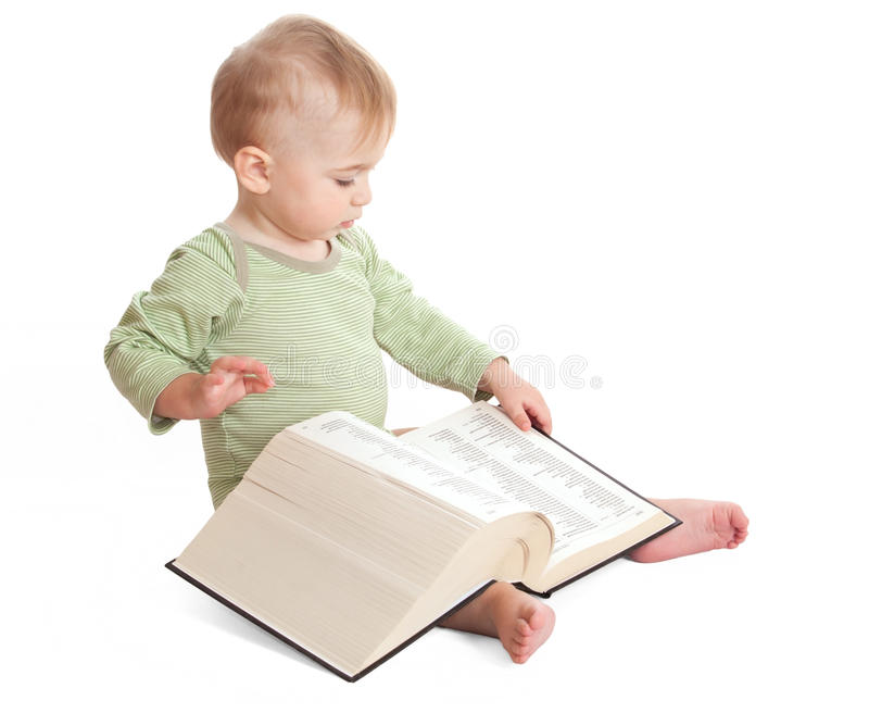 Ребенок с книгой стоковые изображения