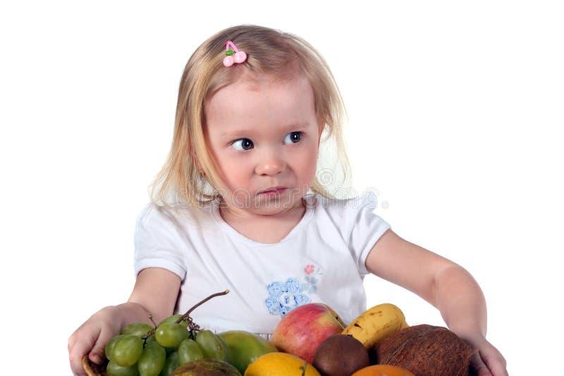 ребенок fruits немногая стоковое изображение