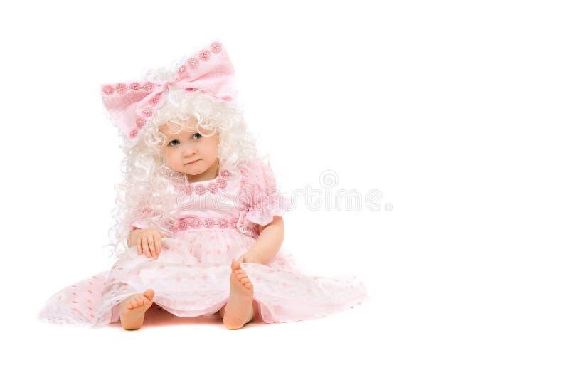 Ребёнок в розовом платье. Изолировано стоковое фото