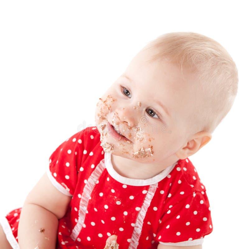 Ребёнок и ее именниный пирог. стоковое изображение rf