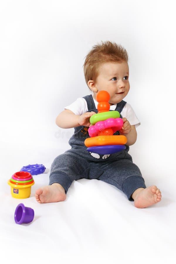 ребёнок над играть белизну стоковая фотография