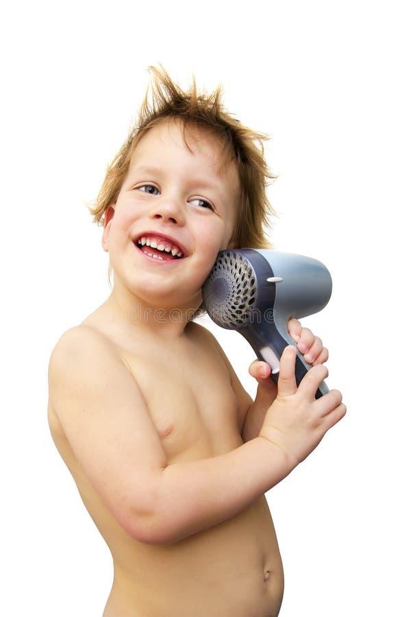 Ребёнок с феном для волос над белизной стоковые изображения rf