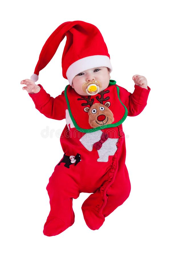 Ребёнок с pacifier или думмичные, красные babygrow или onesie, bib северного оленя Рудольфа, шляпа Санта Клауса для рождества стоковое изображение rf