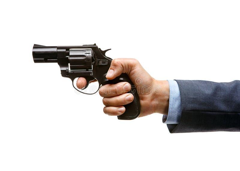 Револьвер в руке стоковое изображение