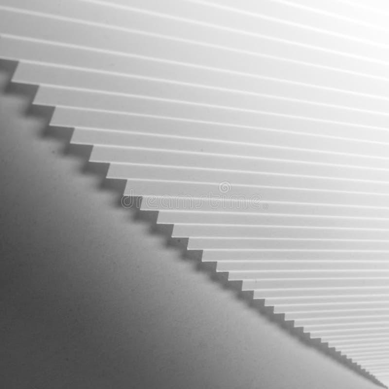 Режущие кромки - слои бумаги в mono стоковые изображения rf