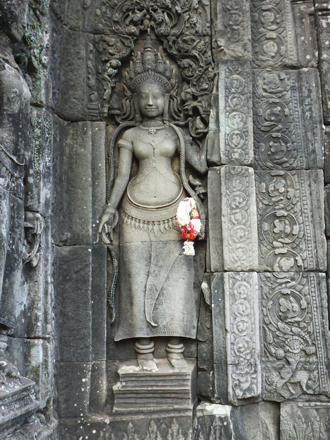 Резное изображение apsaras в виске Ankor Wat стоковое фото