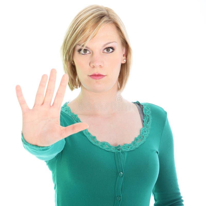 Резолютивная женщина вызывая остановку с ее рукой стоковые фото