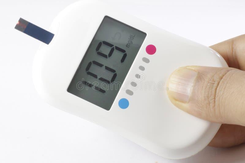 Результат теста сахара Glucometer диабетический стоковое изображение