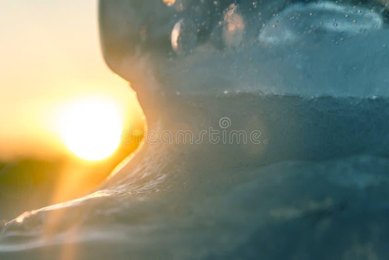 Резюмируйте запачканную предпосылку ледистой текстуры на предпосылке солнца стоковое изображение
