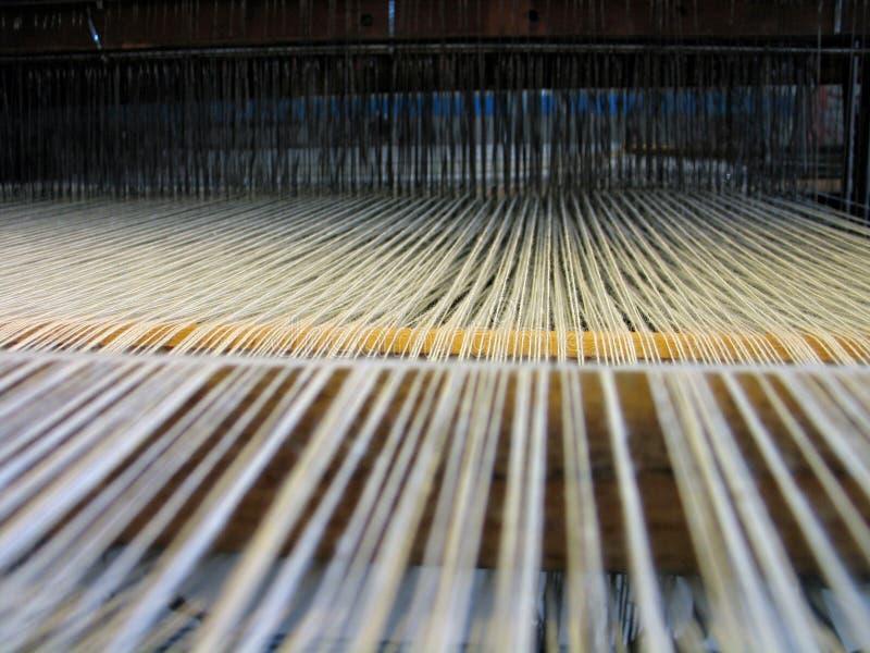 резюмируйте полностью прикрепленное тканье шнуров стоковые изображения