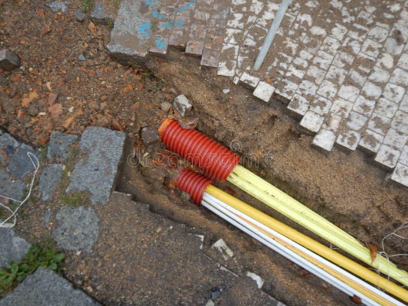 Реконструкция улицы с instalation труб стоковое фото