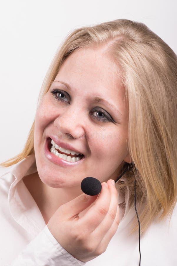Репрезентивный молодой смеясь над женский телефонист стоковое изображение