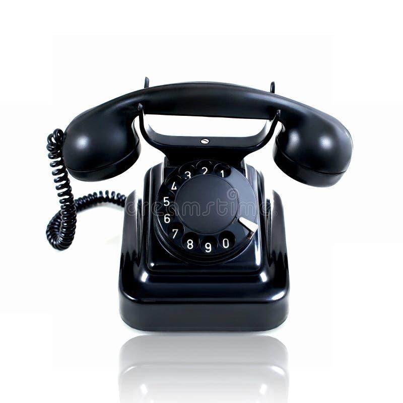 Ретро винтажный роторный изолированный телефон стоковое фото rf