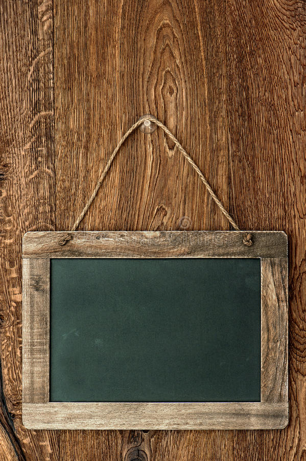 Ретро доска стиля на деревянной стене стоковое фото