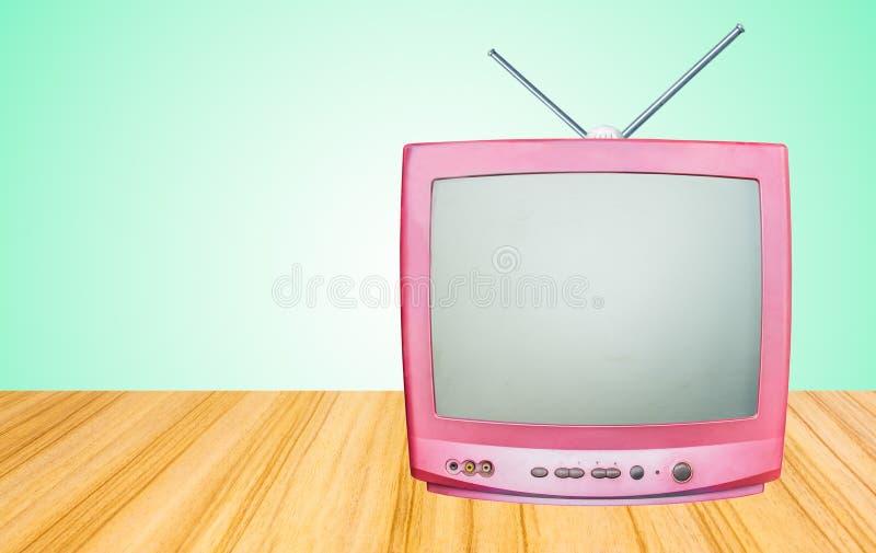 Ретро старый приемник телевидения дальше около таблицы стоковая фотография