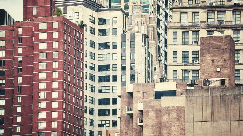 Ретро тонизированное изображение зданий Манхаттана, NYC стоковые фото