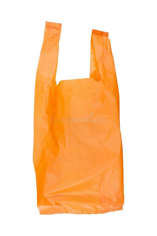 рециркулированный оранжевый полиэтиленовый пакет изолированный на белизне стоковое изображение