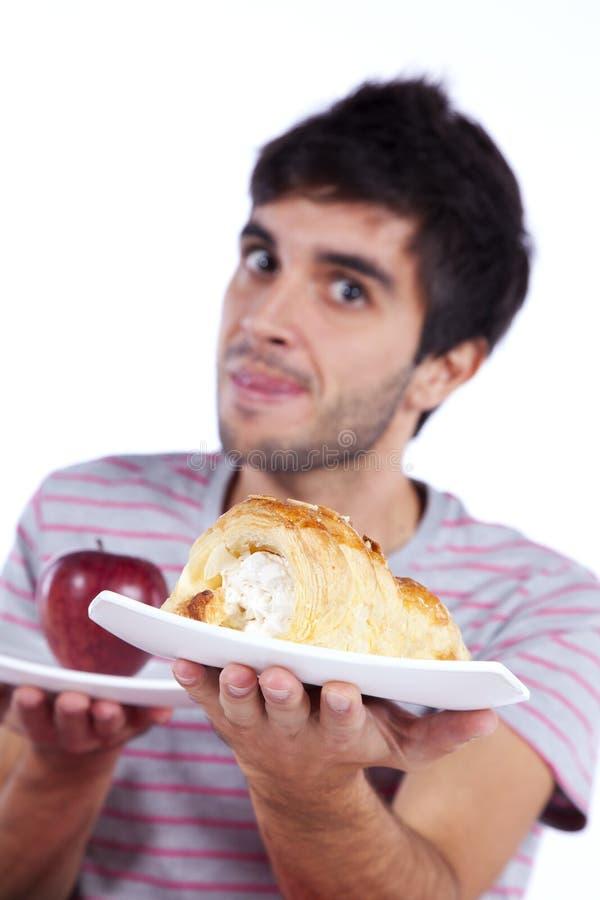 Решение еды молодого человека стоковые изображения