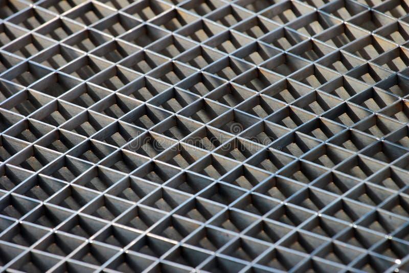 Решетки сброса решеток и металла сточной канавы утюга как предпосылка стоковое изображение