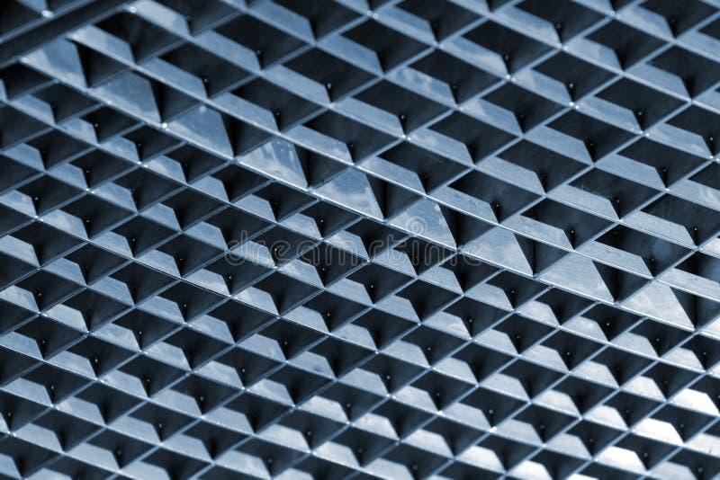 Решетки сброса решеток и металла сточной канавы утюга как предпосылка стоковые изображения