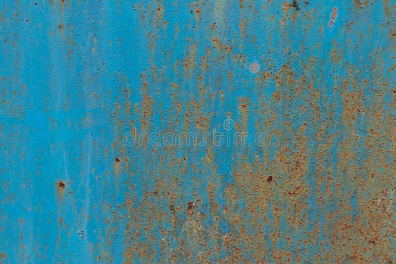 Ржавая покрашенная поверхность как предпосылка Старая затрапезная поверхность стоковые фото