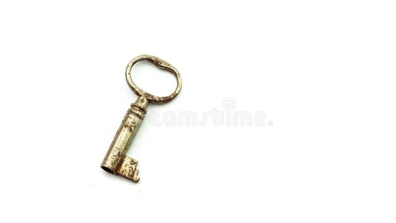 Ржавый старый ключ на белой предпосылке стоковое фото rf