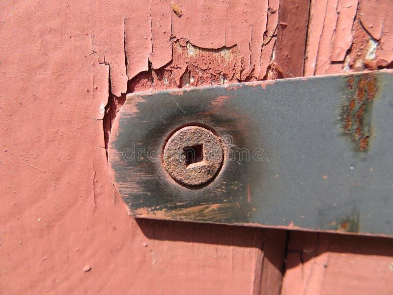 Ржавый шарнир на амбаре - конспекте стоковая фотография