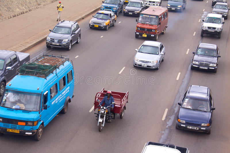 Рикша груза мотоцикла в движении Accra стоковое фото