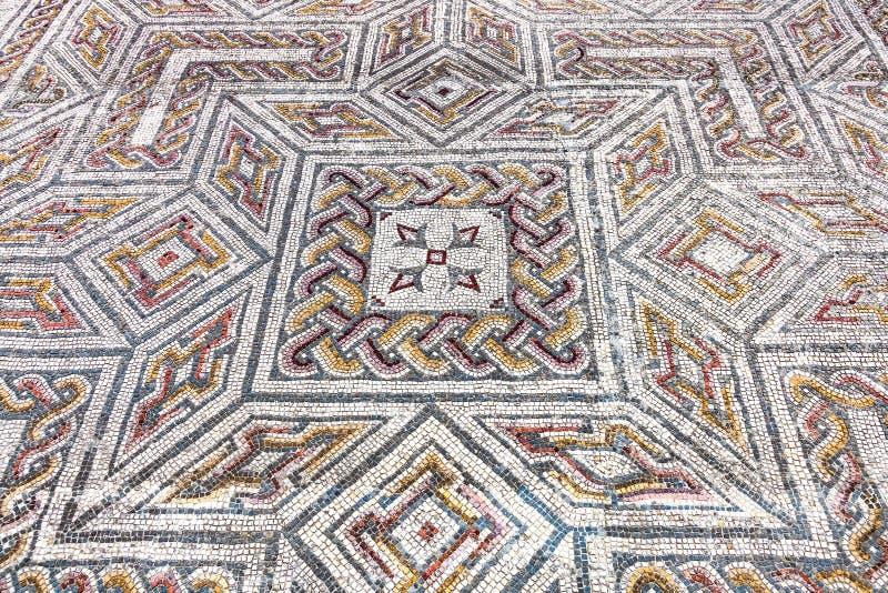 Римские руины Conimbriga Конец-вверх на сложном римском центре мостоваой мозаики tessera стоковое изображение