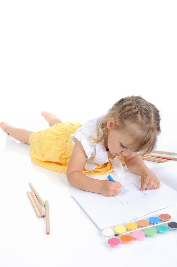 рисует девушку стоковые фото