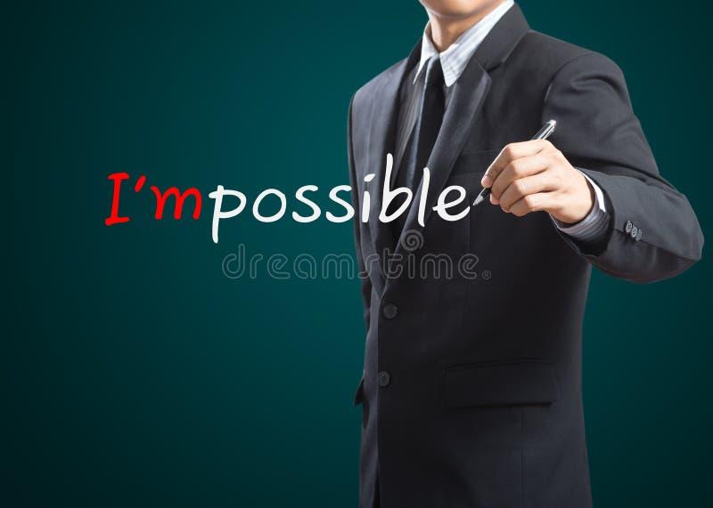 Рисующ и изменяющ слово невозможное к я возможен стоковое фото