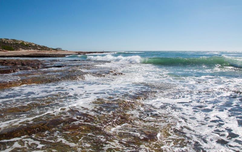 Риф, утес и океан стоковые фото