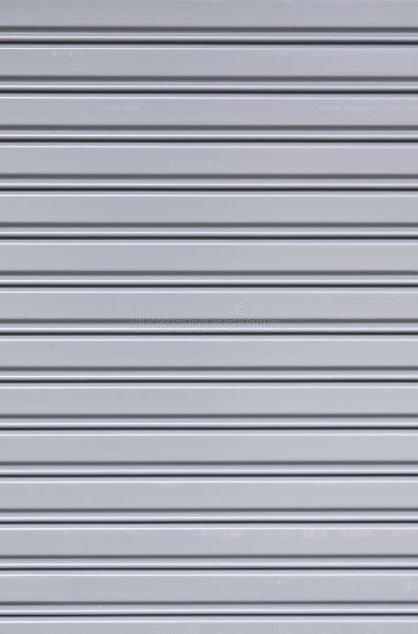 Рифлёная текстура двери скольжения металлического листа стоковые фото