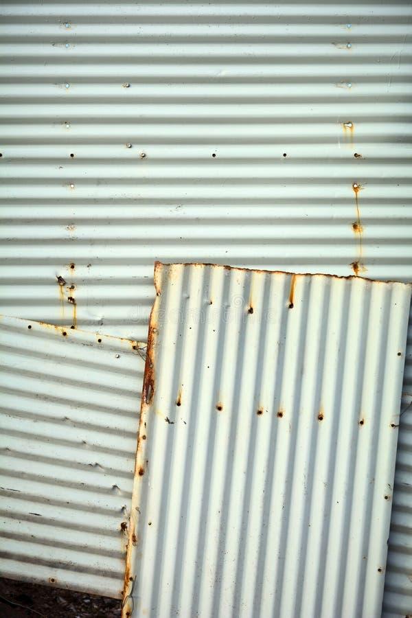 Рифлёная текстура предпосылки стены металла стоковые фото