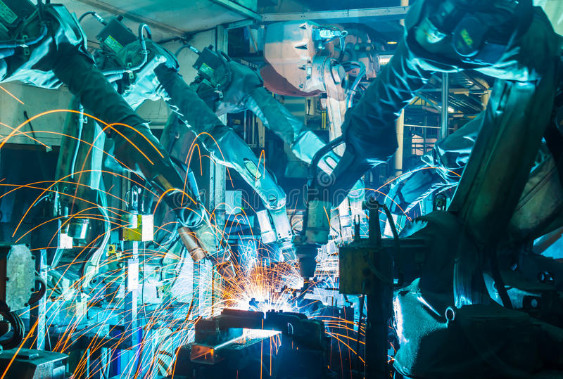 Роботы заварки стоковое изображение rf