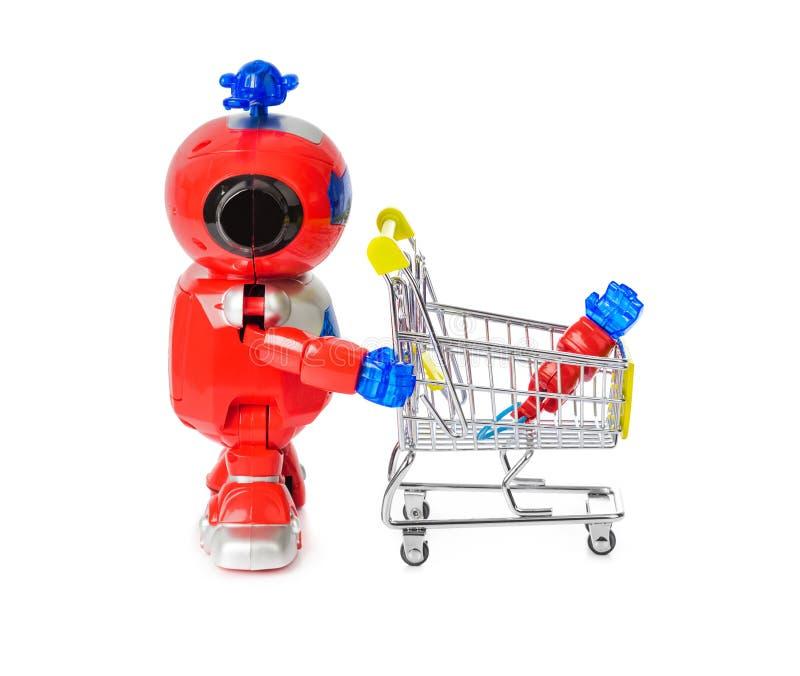 Робот и корзина игрушки с рукой стоковые изображения