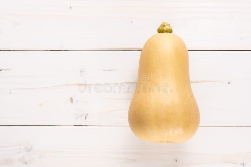 Ровная груша сформировала оранжевое waltham сквоша butternut на серой древесине стоковая фотография rf