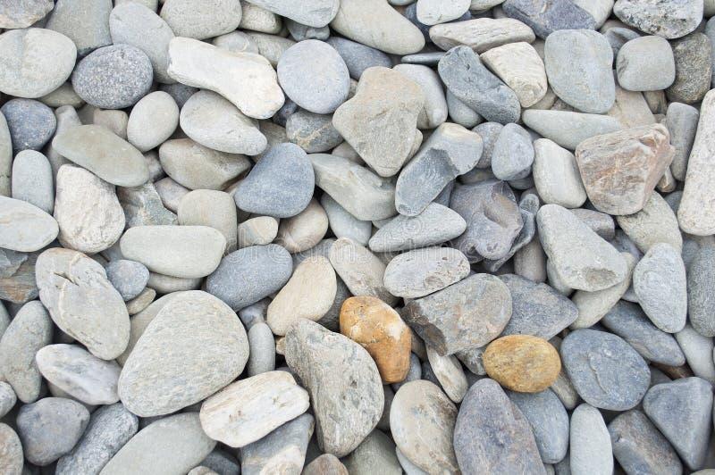 Ровная предпосылка камня пляжа стоковое фото rf