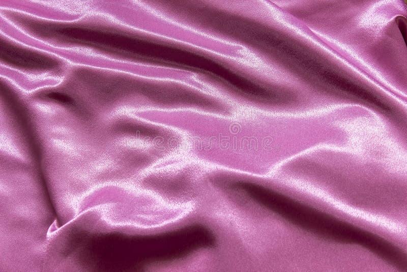 Ровный элегантный розовый шелк Смогите использовать как предпосылка стоковые фото