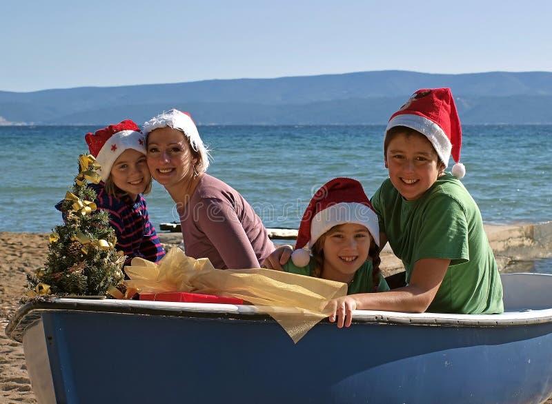 рождество доски обняло семью стоковая фотография