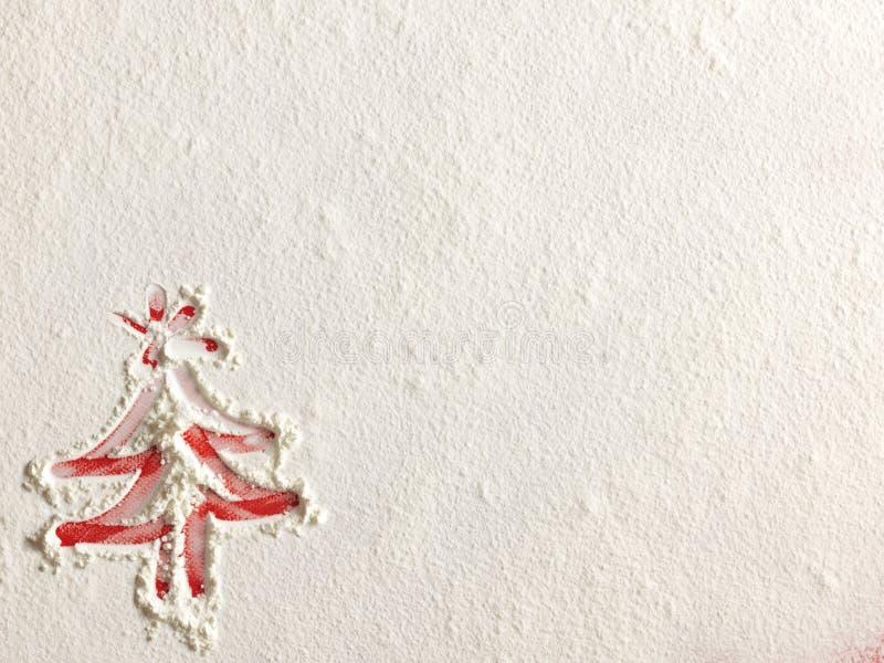 Рождественская елка на предпосылке муки Белая мука выглядеть как снег стоковое изображение rf